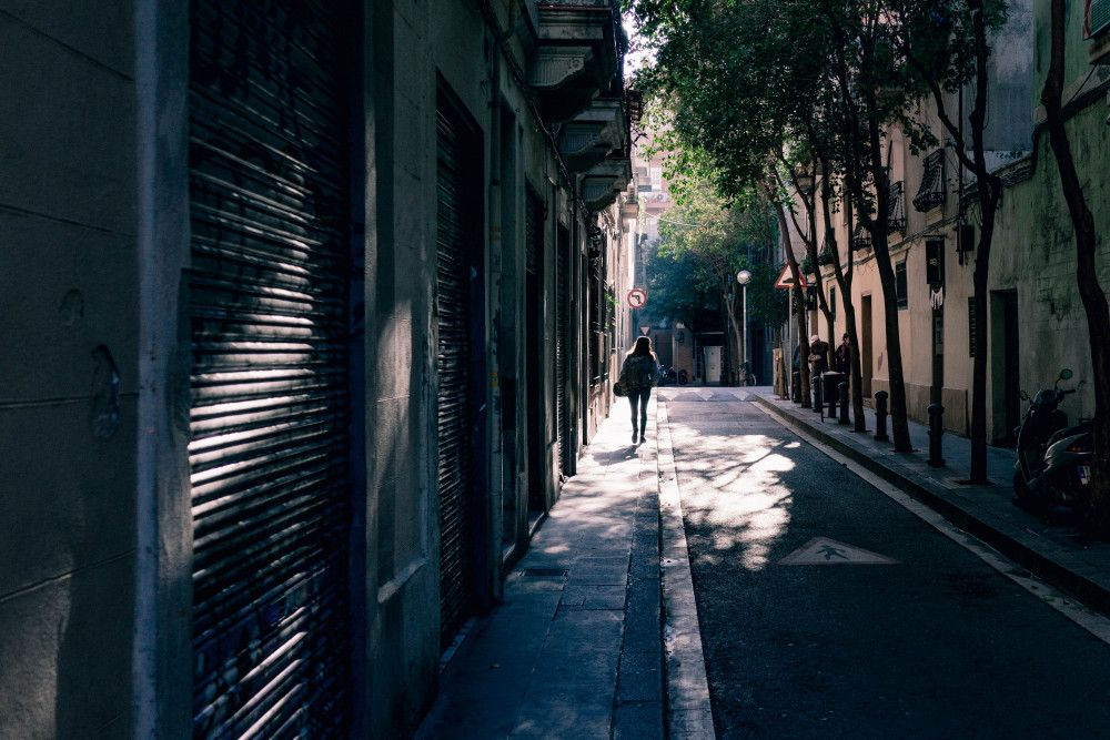 a shade covered narrow street in Madrid