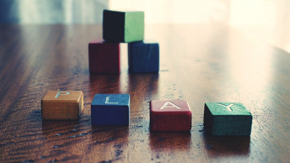 the word play spelt out with childrens wooden toy blocks