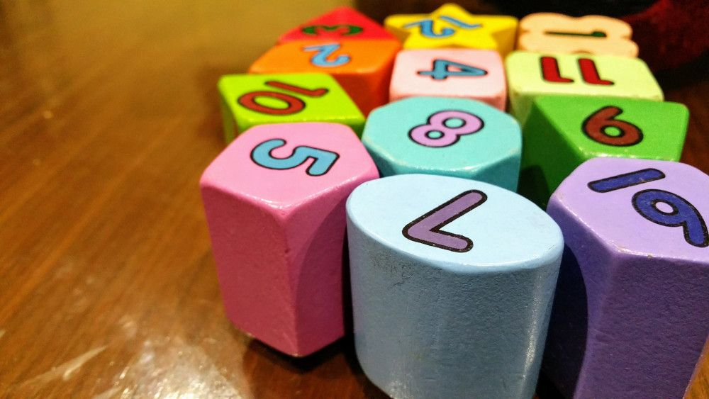 group of different colored toy number blocks