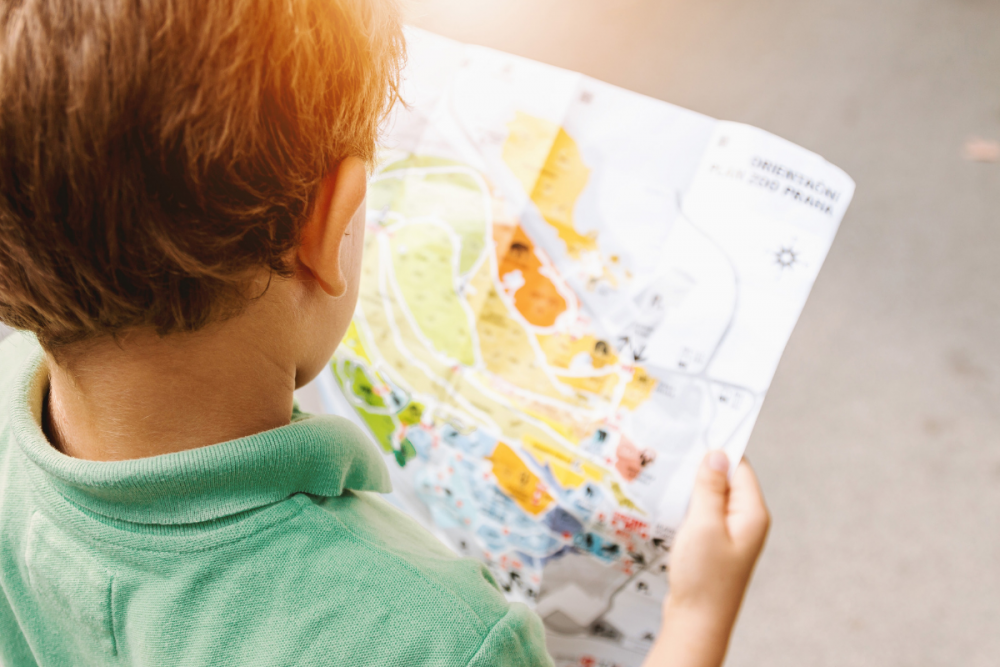 boy holding map