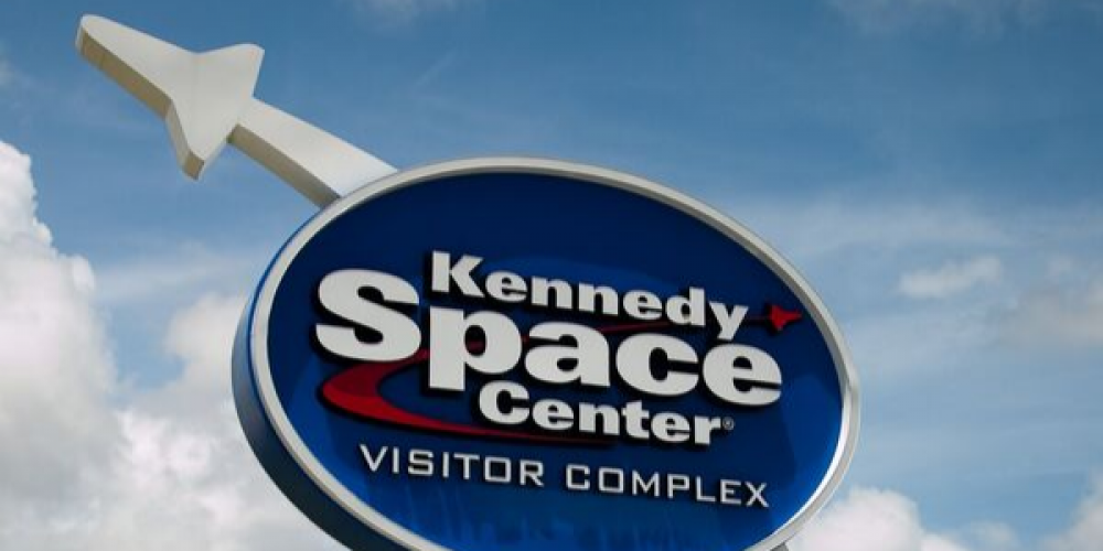 Kennedy CSpace Center Sign Sky Clouds