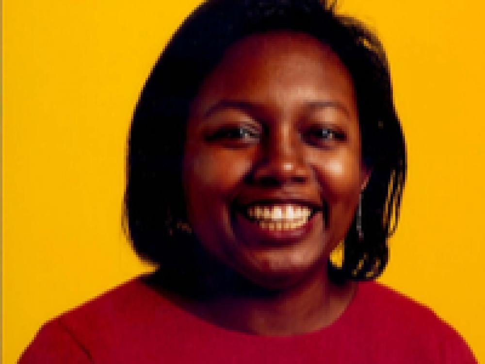 Malorie Blackman Black Woman Yellow Background Red Top